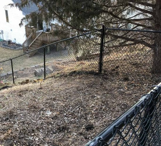 4 Black Chain Link Fence Sloped Yard