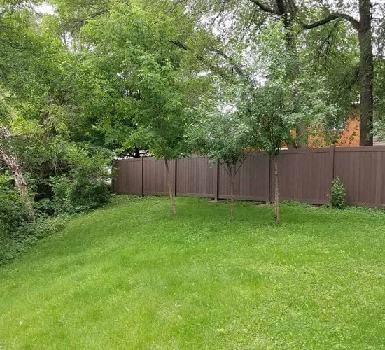 Dark Wood Grain Vinyl Privacy Fence