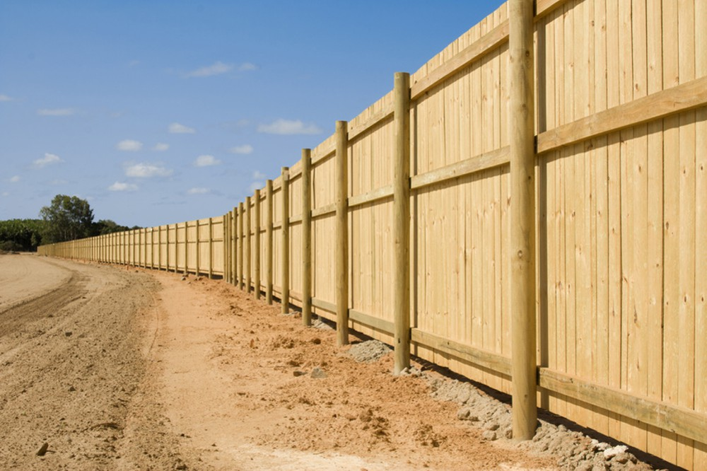 A Long New Fence On New Property Development